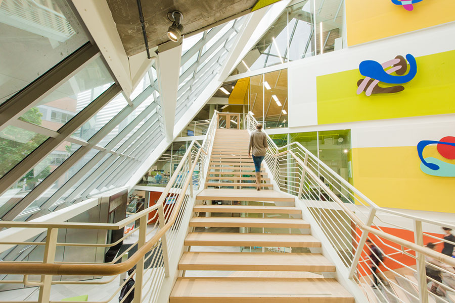 Woman walking up stairs in sustainable building